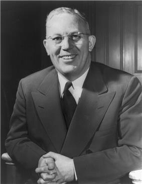 Earl Warren Portrait, half figure, seated, facing front, as Governor.jpg