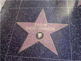 A five-point star engraved on a tile. In the center of the star are the words