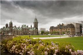 Exterior view of grounds in front of the Centre Block, with the East Block and Langevin Block in the image