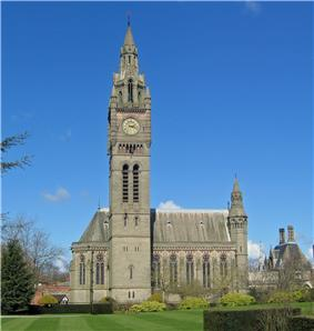 A Gothic Revival chapel with a tall Big Ben-like clock tower