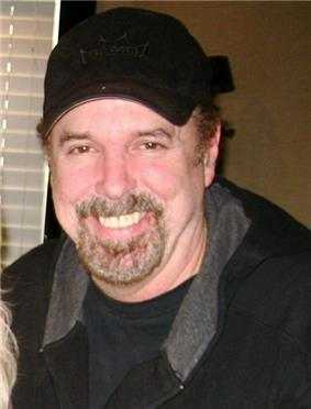 Eddie Bayers wearing a black baseball cap