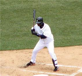 Rentería crouching during an at bat while with the Detroit Tigers.