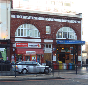 A red-bricked building with a white sign reading