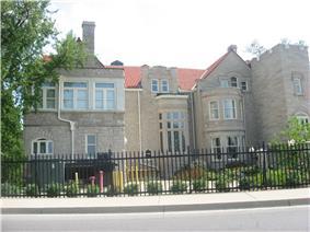Large gated stone mansion