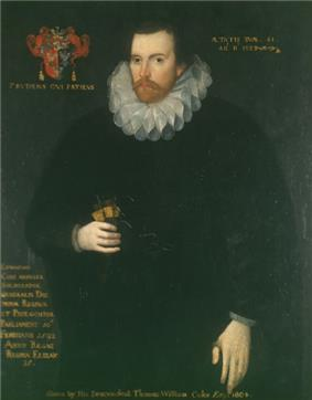 A portrait of a brunette man in his 40s, with a brunette beard and mustache. He is wearing a shapeless black robe and a Jacobean ruff; to the right of his head is a coat of arms with a motto underneath it. On the bottom right of the portrait is a paragraph of indistinguishable text, while the entire picture is captioned
