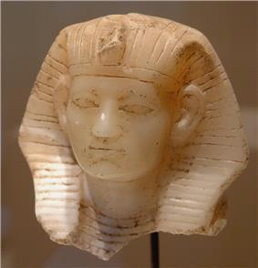 Statuette head of Amenemhat III, now in the Louvre