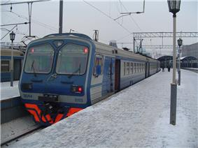 Blue-and-gray passenger train at outdoor station
