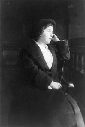 Image of a formally dressed woman, seated, around 1930.
