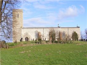 A plain stone church, partly rendered, seen from the south with a tower to the left and the body of the church extending to the right