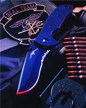 A black recurve bladed knife.