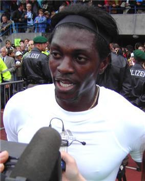 A man wearing a headband, being interviewed