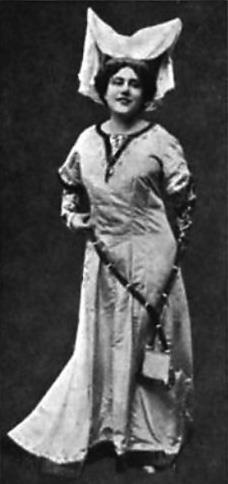 An actress in an elaborate head-dress and peasant costume
