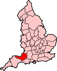 Map of England in pink with the area occupied by Somerset shaded in red