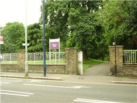 Photograph of an external wall and a gate at the boundary of Westow Park.