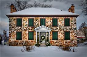Exterior view of Ermatinger House in winter