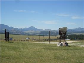 Mountains and grasslands surrounding a work center.