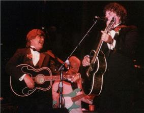 A color photograph of Don and Phil Everly on stage with guitars