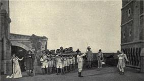 A row of soldiers, left, aim their rifles at a lone figure, right, while (centre) an officer raises his sword as a signal. An agitated woman, extreme left, turns her face from the scene.