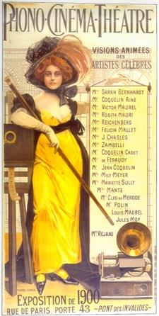 Illustration of a red-haired woman wearing a large hat, an ankle-length yellow dress, and high heels. She is holding a long baton or swagger stick and leaning against a film projector. A gramophone sits at her feet. The top of the illustration reads