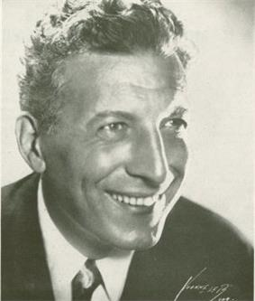 Publicity portrait of a man in his mid-fifties with curly hair (Pinza)