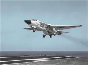White variable geometry-wing jet aircraft landing on carrier
