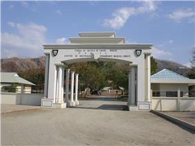 White gates with buildings behind them