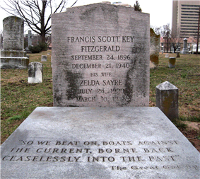 A color photograph of a grave. The headstone reads Francis Scott Key Fitzgerald September 24, 1896 December 21, 1940 His Wife Zelda Sayre July 24, 1900 March 10, 1948.