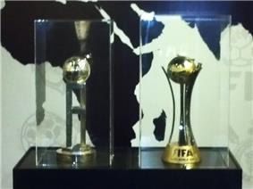 The two trophies of the FIFA Club World Cup are seen.