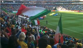 A view of an Italian fan waving his national flag.