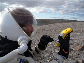 Vernon Kramer uses a Trimble GeoXM GPS to locate the Gemini Hills on EVA 9.