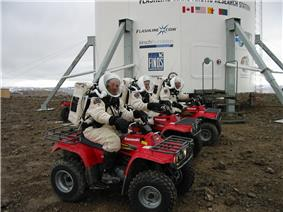 Robert Zubrin, Vladimir Pletser, and Katy Quinn of Crew 2 prepare to begin a motorized EVA on July 15, 2001.