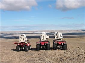 Crew 7 members on a motorized EVA.