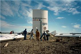 The first set of the station's wall panels are erected on July 20, 2000.