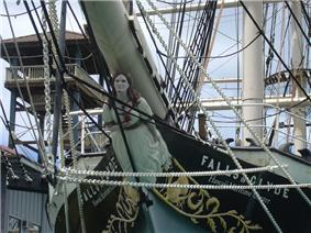 Photograph of the prow of the Falls of Clyde, featuring the female figurehead beneath the bowsprit.