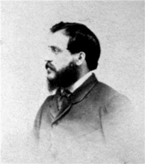 A head-and-shoulders photograph of Felice Beato in profile. He is facing towards the left of the frame and has a full beard.
