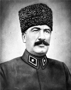 Older, soldier with a mustache wearing a fez