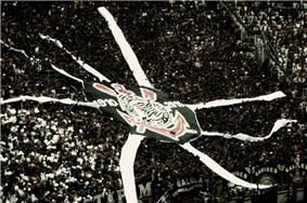A group of fans performing choreography for their club Corinthians.