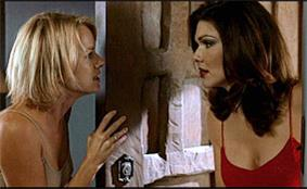Naomi Watts and Laura Elena Harring arguing on two sides of an open door