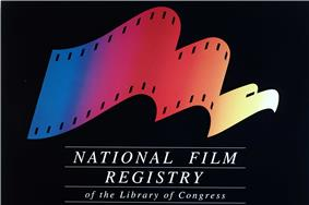 The image includes a logo on a black background. The logo looks like a film reel and changes from left-to-right to an eagle. The logo is multi-colored and below it is the phrase