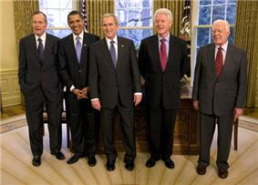 Group portrait of five presidential men in dark suits and ties