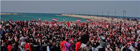Seaside demonstration, with protesters wearing red, white and blue