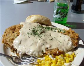 Chicken fried steak topped with gravy