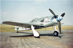 Photo of WWII fighter plane parked on concrete