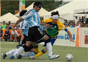 two Argentinian players and one from Brazil running after the ball or falling down