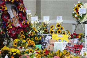Portrait and other tributes, including mural and messages from 650 Spanish fans, letters, pictures, teddy bears, and flowers.