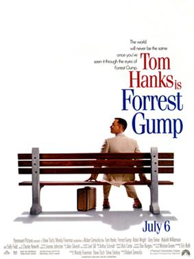 Film poster with an all-white background, and a park bench (facing away from the viewer) near the bottom. A man wearing a white suit is sitting on the right side of the bench and is looking to his left while resting his hands on both sides of him on the bench. A suitcase is sitting on the ground, and the man is wearing tennis shoes. At the top left of the image is the film's tagline and title, and at the bottom is the release date and production credits.