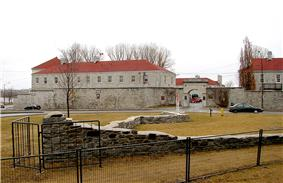 Remnants of the old fort with the new Fort Frontenac in background