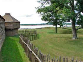 Log structure inside palisade fence