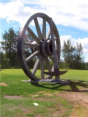 View of large wheel and pick axe at Fort Assiniboine