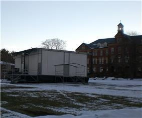 Modular building on snowy college campus.